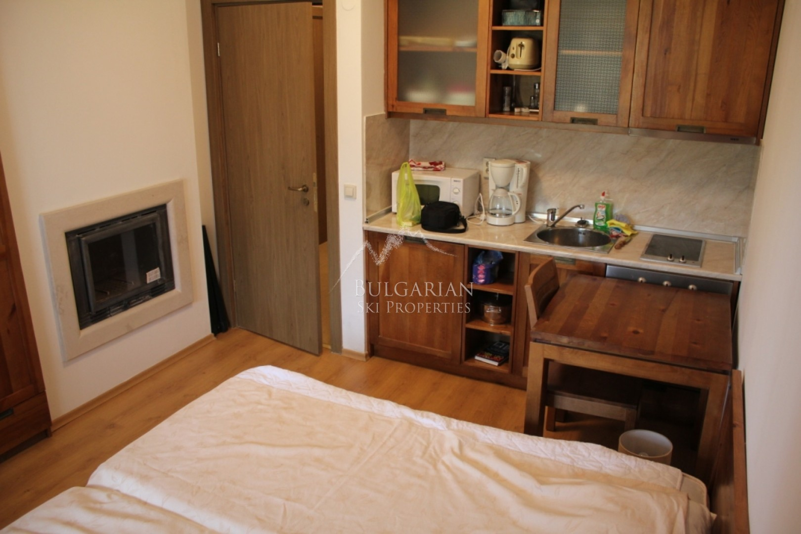 Furnished studio with fireplace for sale in St John Hill, Bansko